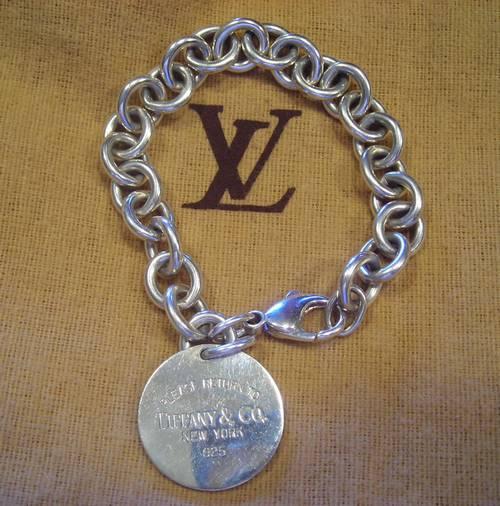 afdfe5d6e Tiffany & Co. Round Tag Charm Bracelet 100% Authentic Silver Pre ...