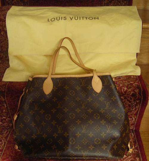 55d2a261a544 I am pleased to present this 100% authentic Louis Vuitton Neverfull MM Tote.  It includes original LV receipt