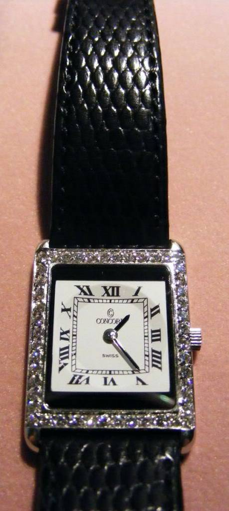 Concord Delirium Tank Style Ladies Watch With Diamond