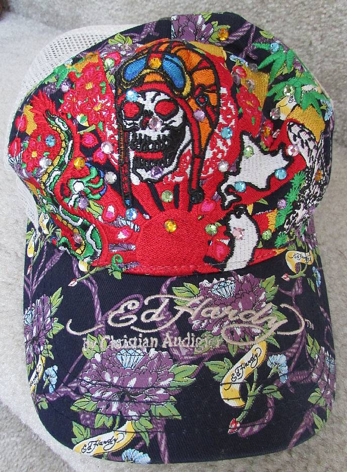 Available today is a great Ed Hardy mesh trucker hat. Hat has colored  stones included with the embroidered design. Cap is in good used condition  with some ... 08964ab73e1