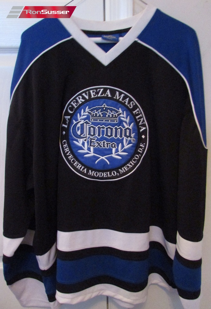 I am pleased to offer this great Corona Extra beer hockey jersey. Shirt is  made from 100% polyester. Size is XL. Excellent pre-owned condition. 2ad8efddbcf
