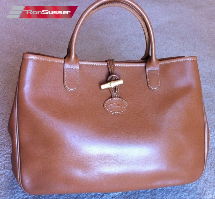 84d235f60d I am pleased to offer this beautiful vintage Longchamp brown leather tote.  It has been gently used and has a few marks/scratch towards the bottom  front and ...