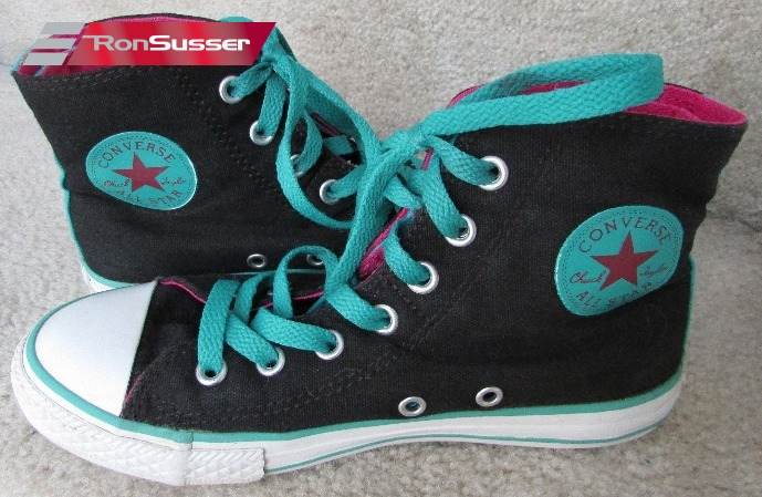 20458221fdfe Available today is a great pair of Converse All Star Hi Top sneakers in  size youth 2. Great black color with pink and teal accents.